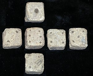 Dice - Composite image of all sides of a 12mm Roman die, found in Leicestershire, England