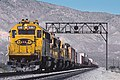 ATSF 5861 just north of Mojave, CA in March 1988 (27846691444).jpg
