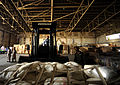 A Pakistani man operates a forklift, moving pallets of food out of the hangar to a designated spot for air transport at Pakistan Air Force Base Chaklala, Pakistan, Aug. 28, 2010, in support of flood relief 100828-F-KV470-003.jpg