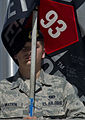 A U.S. Airman with the 11th Security Forces Group carries a flag during a 9-11 memorial ruck march Sept 120911-F-MG591-009.jpg