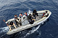 A joint boarding team of U.S. Coast Guard, Navy and Gambian navy service members deploy in a rigid hull inflatable boat from the guided missile frigate USS Simpson (FFG 56) to inspect a fishing vessel 120619-N-GN377-030.jpg