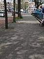 A picture of shadows of trees on the pavement of the Prins Hendrikkade; high resolution image of FotoDutch in June 2013.jpg