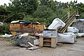 A rusty skip and rubbish at Hatfield Broad Oak Essex England.JPG