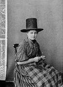 A woman in national dress and knitting (Goodacre) NLW3362591.jpg