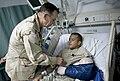 Adm. Mike Mullen presents a Purple Heart medal to an Army soldier at Bagram Air Field, Afghanistan, 2009 (090714-N-0696M-355).jpg