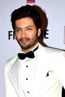 Ali Fazal looking away from camera