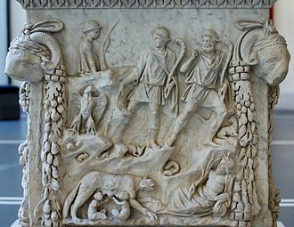 Ab Urbe Condita Libri - Stories from Livy I.4, on an altar panel from Ostia. Father Tiber looks on at the lower right while the national lupa (wolf) nourishes Romulus and Remus, founders of Rome. The herders are about to find them. One of their goats can be seen. Small animals denote the wildness of the place. The national aquila (eagle) is portrayed.