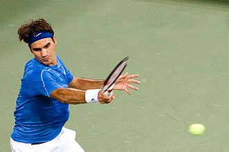Roger Federer - Federer hits a forehand at the 2006 US Open, where he became the first man in history to achieve the Wimbledon-US Open double for three consecutive seasons