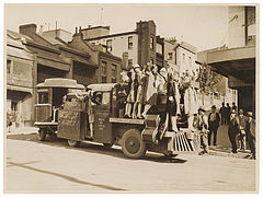 "American women's jazz band ""Ingenues"" and the ""Trackless Train"", Sydney, late 1920's - Sam Hood (3445851889).jpg"