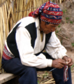 Amerindian man knitting.png