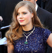 Amy Adams looks away from the camera