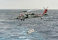 An MH-60S Sea Hawk helicopter carries ordnance. (39305851940).jpg