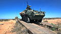 An armored fighting vehicle operated by Charlie Company, 3rd Battalion, 41st Infantry Regiment, crosses an armored vehicle-launched bridge during training near Orogrande, N.M., April 1, 2012 120401-A-DL887-003.jpg