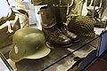Army uniforms of Norway. Field uniform (feltuniform) M1951 German Stahlhelm helmet (tyskerhjelm) Laced ankle boots Anklets gaiters (gamasjer) American helmet Mesh net cover Backpack etc. Armed Forces Museum (Forsvarsmuseet) Oslo 2020.jpg