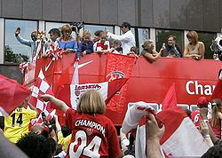 A photograph of Arsenal supporters celebrating the club's achievement with a parade which took place at Islington