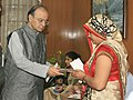Arun Jaitley handing over the additional ex-gratia to the next of kin of battle casualties from the Army Battle Casualties Welfare Fund, which is contributed by concerned citizens, in New Delhi.jpg