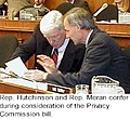 Asa Hutchinson and Jim Moran confer during consideration of the Privacy Commission bill.jpg
