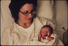 At Calggett Memorial Hospital--Walter Solon Moyer III, the First Baby of the New Year, and His Mother, 01-1973 (3815841516).jpg