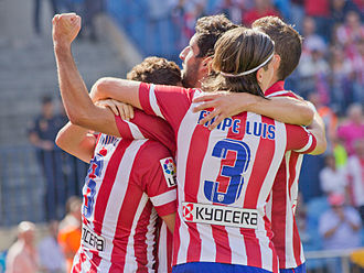 Scoring in association football - Atlético Madrid players celebrate a goal with a group hug