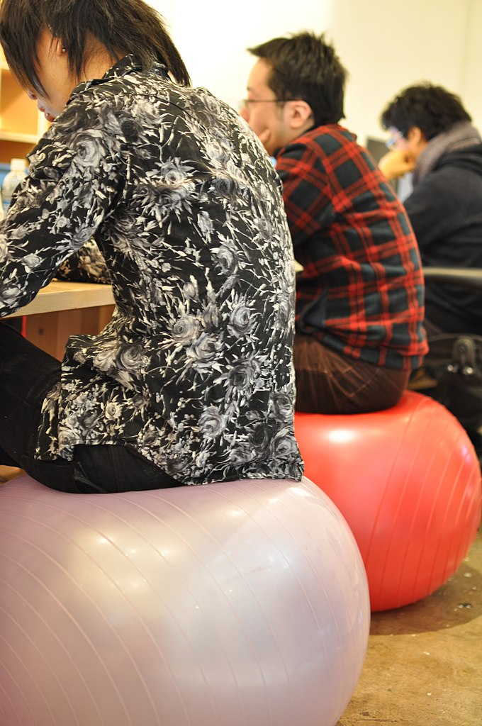 Students sitting at desks on sitting balls while learning