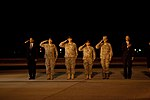 Barack Obama and generals saluting U.S. personnel who died in Afghanistan