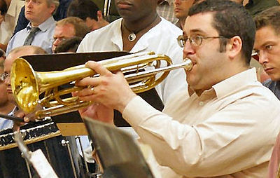 Duncan Wilson playing rotary bass trumpet in C with the BBC Symphony Orchestra Basstrumpeter.jpg