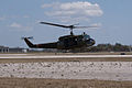 Bell UH-1H Iroquis Huey Coming to Land 04 TICO 13March2010 (14412793958).jpg
