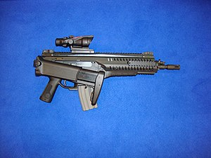 Beretta ARX160 - The ARX160 A2 with the stock folded, an ACOG equipped, and the bolt assembly in full forward position.