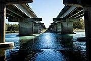 view across a river between two bridges