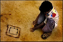 Boy playing marbles in Gujarat village.jpg