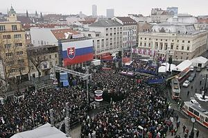 Town square - President George W. Bush and Slovakia's Prime Minister Mikulas Dzurinda are greeted by a crowd of thousands gathered in Bratislava's Hviezdoslavovo Square