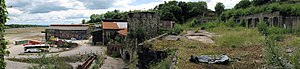 Brymbo Steelworks - Panoramic view, taken from the old blast furnace charging bank, of a small part of the former steelworks site. At the centre is Wilkinson's original No. 1 blast furnace, later used as a sand hopper. The plateau in the distance was later the site of the main melting shop
