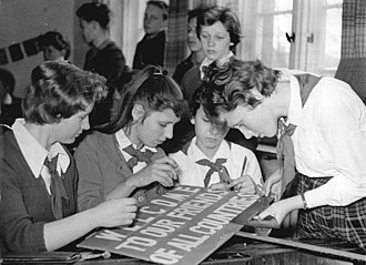 Peace Race - German schoolgirls in Tessin (Rostock, Mecklenburg) making an English-language sign to be used to greet riders in the 1961 Peace Race.