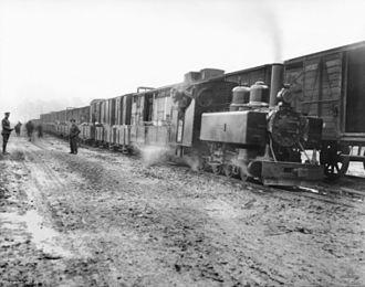Trench railways - Transfer of ammunition from standard-gauge railway to trench railway during the Battle of Passchendaele.