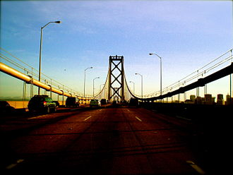 William Gibson - The San Francisco–Oakland Bay Bridge, a fictional squatted version of which constitutes the setting for Gibson's Bridge trilogy