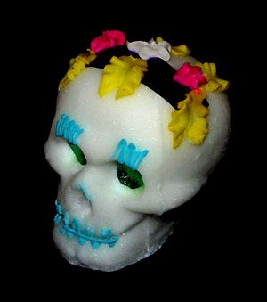 Human skull symbolism - Sugar skull given for the Day of the Dead, made with chocolate and amaranth