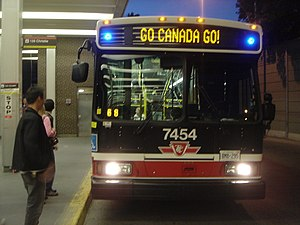 Toronto Transit Commission accessibility - Blue indicator lights on both sides of the route sign indicate the bus is low-floor and wheelchair friendly