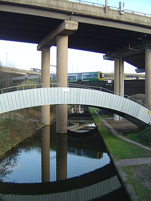 Gravelly Hill Interchange - The Cross City Line and Tame Valley Canal passing underneath the motorway complex
