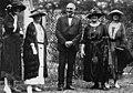Carrie Chapman Catt and Marie Stewart Edward next to Warren G. Harding on Social Justice Day, October 1, 1920.jpg