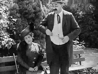 ファイル:Caught in the Rain (1914).webm