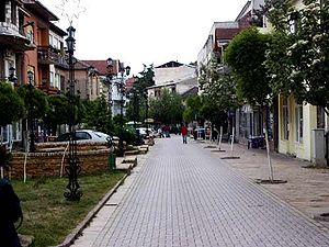 New pedestrianism - Principles of New Pedestrianism at a street in the renewed city center of Radovish, Republic of Macedonia. Pedestrians are dominant, but there is also place for cars (parked on the left).