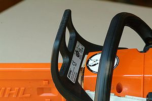 Chainsaw safety features - Front handguard, and combined chain brake lever