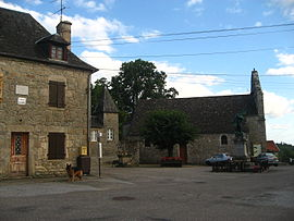 The church and surrounding buildings in Champagnac-la-Prune