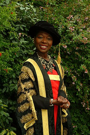 Academic dress of the University of Exeter - Chancellor Floella Benjamin wearing the Chancellor's Robe