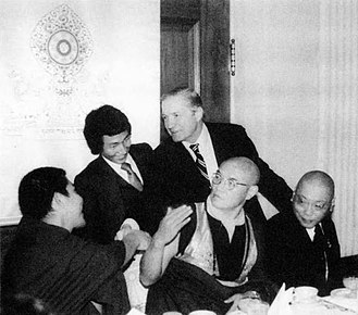 Charles H. Percy - 1980 luncheon in honor of the 16th Karmapa at the U S Capitol. Tibetan Buddhists (seated left to right) Jamgon Kongtrul Rinpoche, 16th Karmapa, Chogyam Trungpa. Standing is an unknown translator and Senator Charles Percy, Chairman of the Foreign Relations Committee