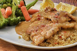 Wine sauce - Chicken in wine sauce over couscous