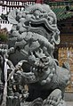 Chinese stone lion at the entrance to the Potala Pallace.jpg