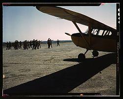 Civil Air Patrol Members Exercise Near A CAP Plane At Bar Harbor, Maine, In  1943.