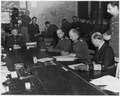 Colonal General Alfred Jodl, Chief of Staff under the Doenitz Regime, signs the document of unconditional surrender.... - NARA - 195338.tif
