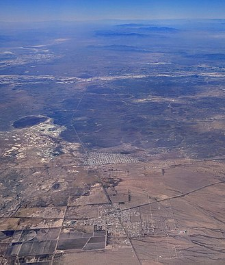 Puerto Palomas, Chihuahua - In this aerial photograph looking over Columbus, New Mexico (foreground), Puerto Palomas is in the center, with its near edge defining the international border.